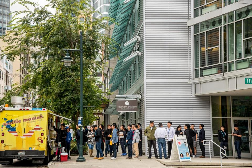 Amazon employees stood in line for one of the many food trucks that descend daily to feed the thousands of the company's workers.